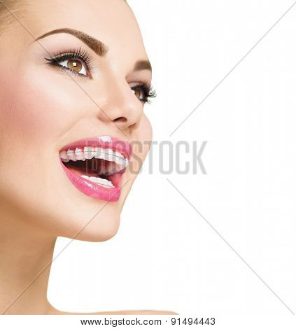 Braces. Beautiful Woman smile close up. Healthy Smile. Closeup Ceramic Braces on Teeth. Beautiful Female Smile with Braces. Orthodontic Treatment. Dental care. Alignment of teeth. Aesthetic dentistry