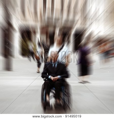 Abstract Background . A Disabled Person In A Wheelchair On A City Street. Radial Zoom Blur Effect