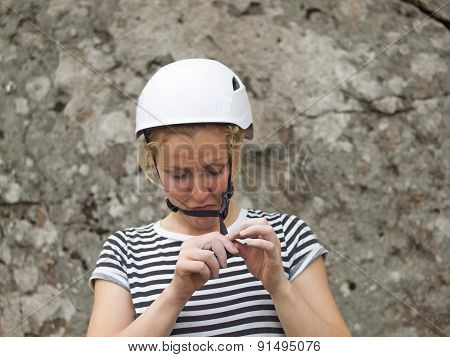The Girl Wears A Helmet For The Best Protection.