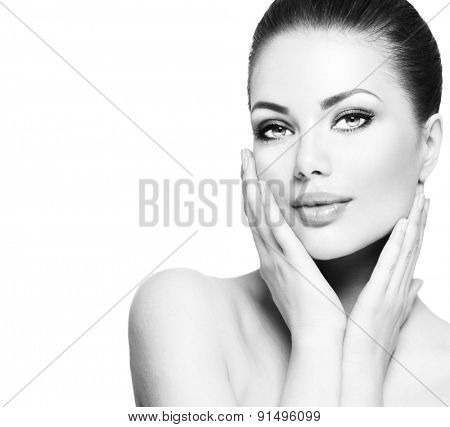 Beauty Portrait. Beautiful Spa Woman Touching her Face. Perfect Fresh Skin. Beauty brunette Model. Youth and Skin Care Concept. Black and white Studio shot