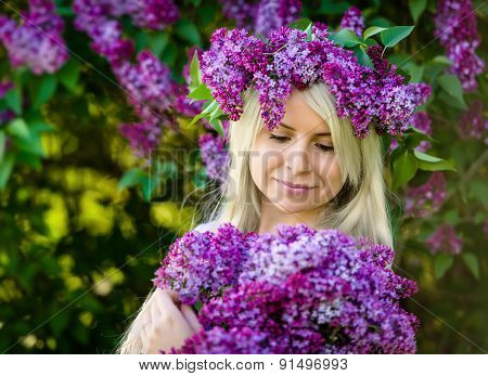 Beautiful Smiling Young Blonde Woman Is Wearing Wreath Of Lilac
