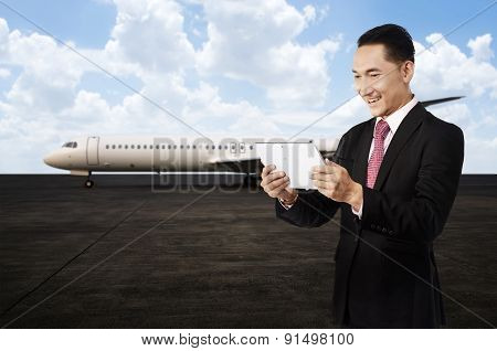 Young Business Man Using His Tablet On The Airport