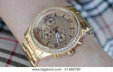 Women's Gold Watch On The Hand