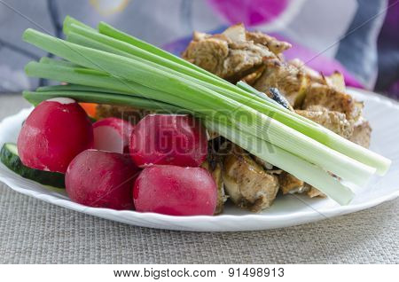 Mini Skewers Of Chicken And A Side Dish Of Fresh Vegetables