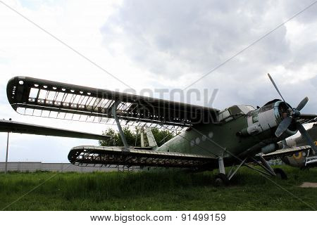 Old biplane with broken wings