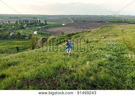 Little Girl Running On Meadow