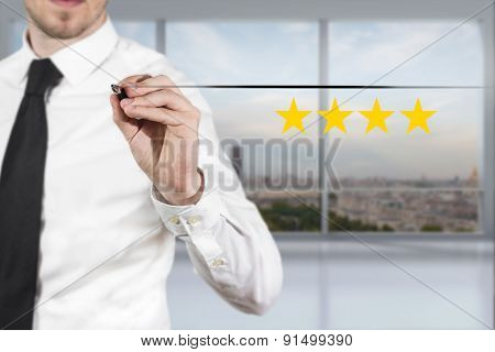 Businessman In Office Pushing Button Four Golden Rating Stars
