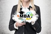 stock photo of degree  - Blonde business lady is holding a cloud with business education icons - JPG