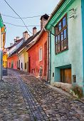 foto of cobblestone  - Cobblestone street with colourful houses in Sighisoara - JPG