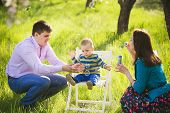 pic of blowing  - father and mother blowing soap bubbles - JPG