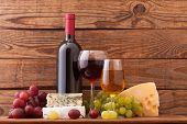 stock photo of merlot  - Wine and cheese on wooden background - JPG