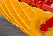 pic of tractor-trailer  - Close up of new yellow agricultural connection machine for tractor  - JPG