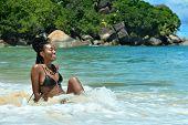 foto of wallow  - beautiful young girl sitting on the beach - JPG