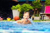 picture of excite  - excited happy kid boy jumping in pool water fun - JPG
