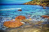 stock photo of shoreline  - red rocks in Castelsardo shoreline - JPG
