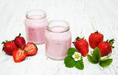 picture of strawberry  - Strawberry yogurt with fresh strawberries on a wooden background - JPG