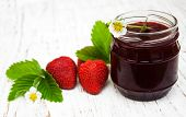 pic of strawberry  - Strawberry jam and fresh strawberries on a wooden background - JPG