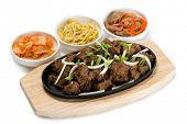 picture of korean  - Roasted lamb with onions in a skillet and salads heh - JPG