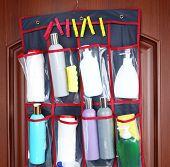 foto of detergent  - Different detergents in hanging bag wooden door - JPG