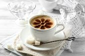 pic of latte  - Cup of latte coffee art on wooden table - JPG