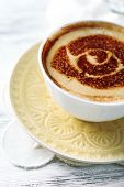 foto of latte  - Cup of latte coffee art on wooden table - JPG