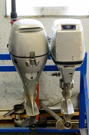 picture of outboard engine  - two outboard motors in a repair shop - JPG
