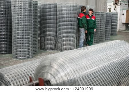 Leningrad Russia - April 6 2012: Plant for production of fences. Workshop packing wire mesh netting. Mesh netting in rolls