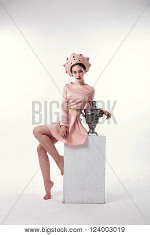 Gorgeous Woman With Brunette Hair In Russian National Hat With Samovar