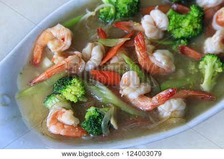 Prawn in sauce with a vegetables close up