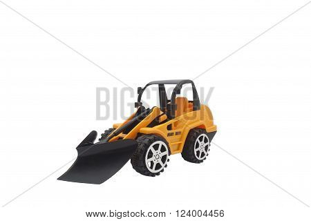 Isolated tractor toy photo. Isolated black and yellow tractor toy side view photo.