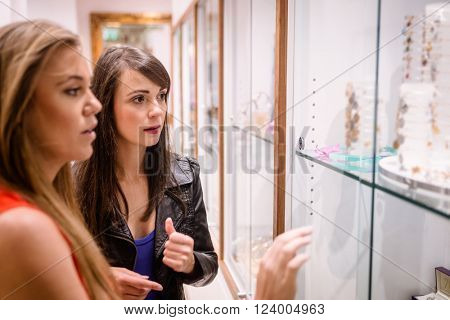 Two beautiful women shopping in a jeweler shop