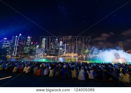 SINGAPORE CITY, SINGAPORE - FEBRUARY 17, 2016: Marina Bay Sands at night during Light and Water Show 'Wonder Full' . It opened on 27 April 2010. Singapore on FEBRUARY 17, 2016