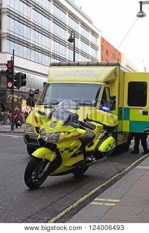 LONDON UNITED KINGDOM - DECEMBER 28: Ambulance responder in London on DECEMBER 28 2009. Ambulance motorcycle and emergency van at street in London United Kingdom.