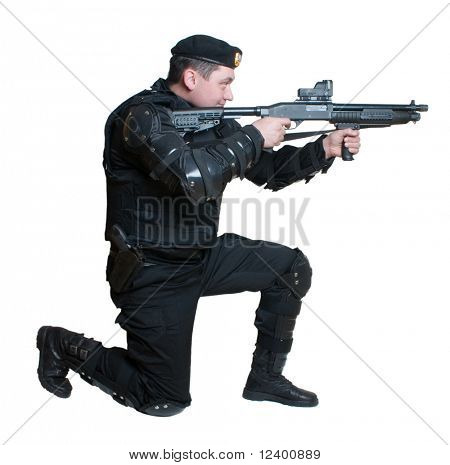 Full body view of police officer  in action