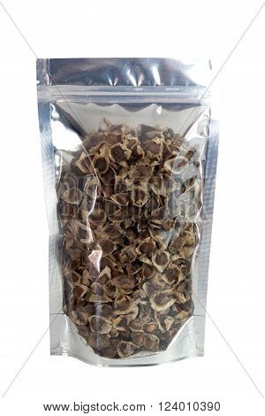 Dried Moringa Seeds in packaging foil zip lock bag. Isolated on white with clipping paths. food ingredient. Substitute drug treatment for skin hydration.
