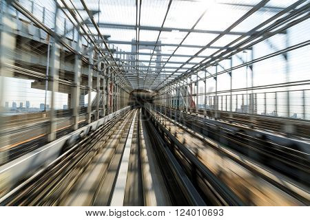 Fast train passing through tunnel