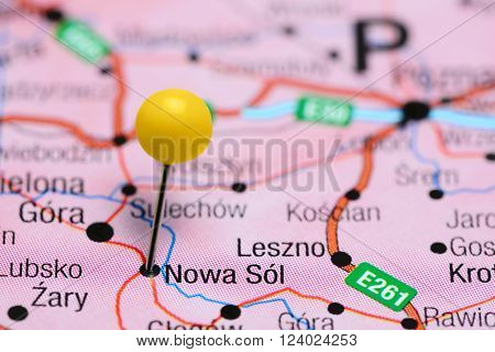 Photo of pinned Nowa Sol  on a map of Poland. May be used as illustration for traveling theme.