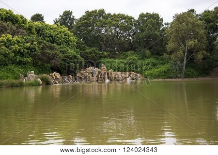 A small scenic pond with watefalls and rocks near Joondalup HBF Arena in Perth Western Australia
