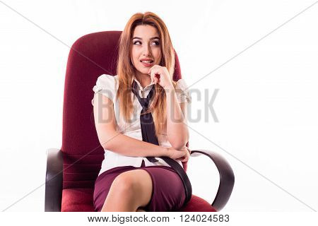 business woman on office chair thinks of something sly facial expression,