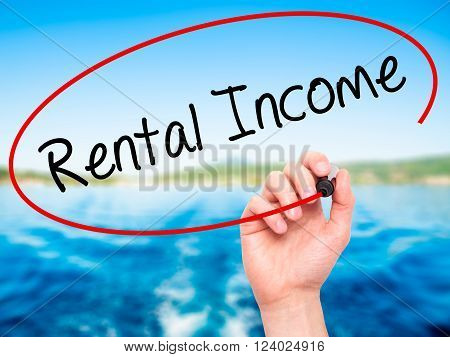 Man Hand Writing Rental Income With Black Marker On Visual Screen.