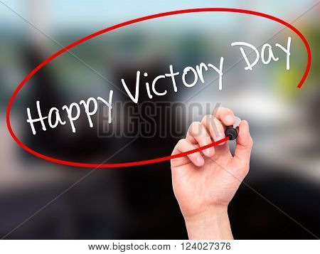 Man Hand Writing Happy Victory Day With Black Marker On Visual Screen.