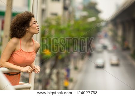 Beautiful Asian woman standing on the overpass.