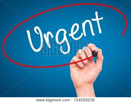 Man Hand Writing Urgent With Black Marker On Visual Screen.