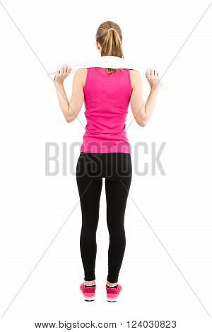 Back of fitness woman full length.Woman after fitness taking a break. Rearview. Isolated on white background.