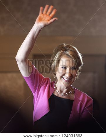 MADISON WI/USA - March 30 2016: Former Republican presidential candidate Carly Fiorina waves to a group of supporters during a rally for presidential candidate Ted Cruz in Madison Wisconsin.