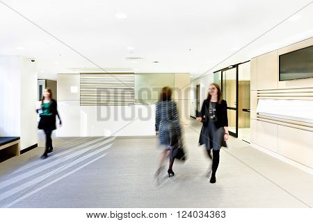 Modern reception room with omen showing blurred movements