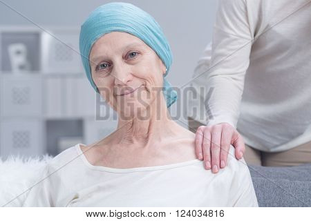 Sick older woman with cancer with inner strength to fight with disease