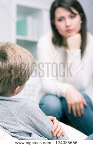 Young worried mother having problem with her little son