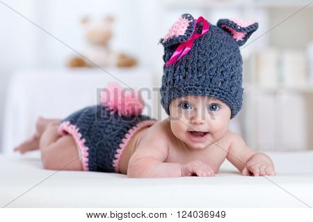 happy baby child in costume a rabbit bunny at home
