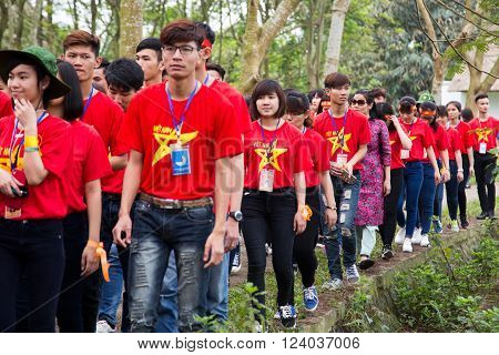Hanoi, Vietnam - Mar 26, 2016: Vietnamese youth volunteer matching at an event for social community and environment activities outdoor in a country area.